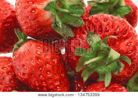 Fresh strawberries piled high ready to eat