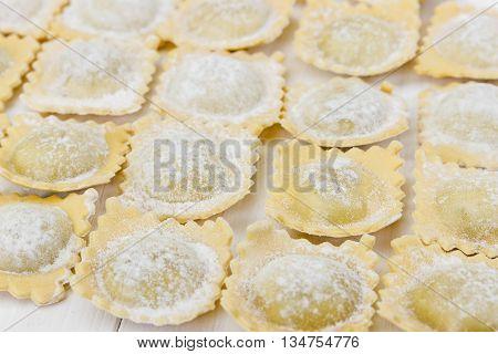 Traditional Italian Ravioli On White Wooden Background