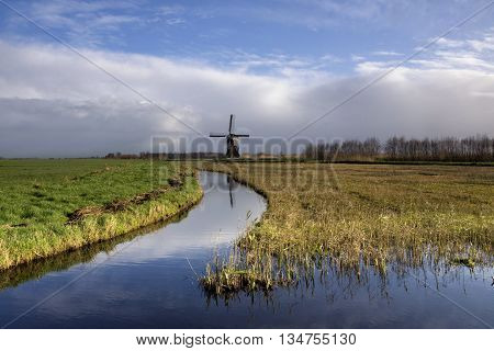 Dutch polder landscape with a windmill in the region Alblasserwaard
