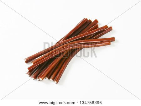 cola candy sticks on white background