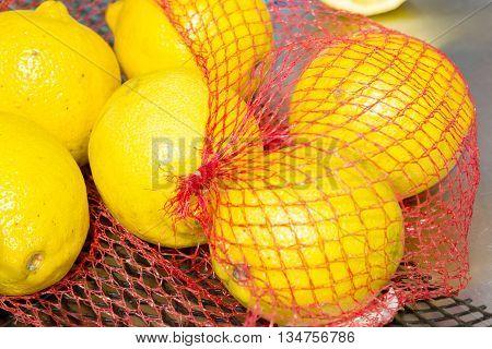 Lemons In Net Packaging In The Grocery Store