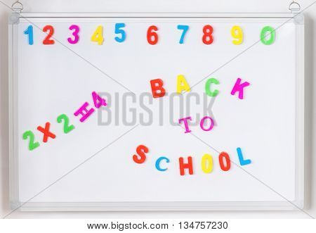 Colorful back to school alphabet letters on whiteboard