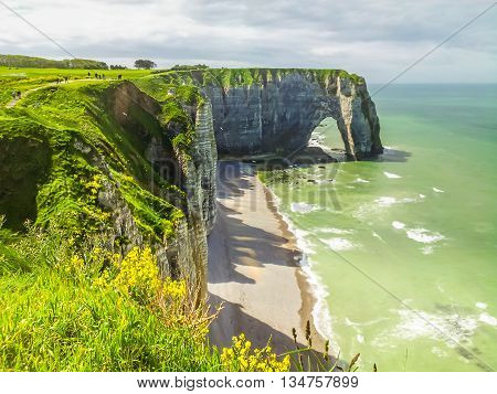 Cote d'Albatre or Alabaster Coast is part of the French coast of the English Channel. Famous cliff Porte d'Aval. Etretat France