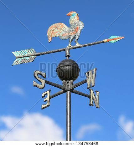 Weathervane With Rooster Above An Arrow And The Four Cardinal Points