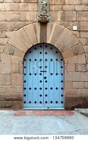 wooden gate in a stone wall the middle ages Spain