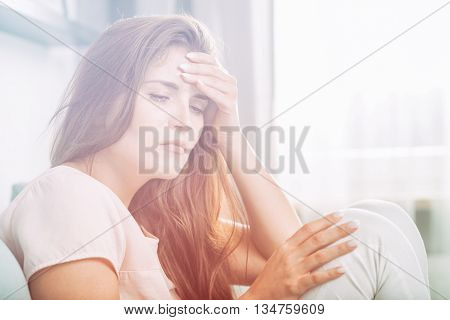 Young Woman With Headache Lying On Couch At Home. Casual Style I