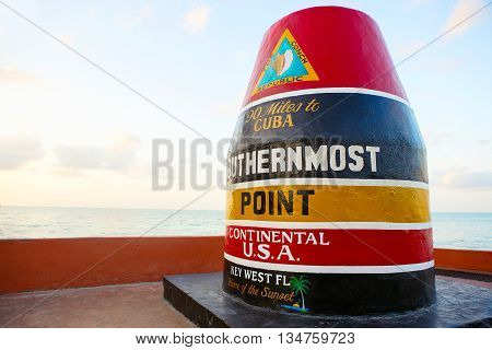 Southernmost point in continental USA on sunrise in Key West, Florida. Famous point for tourists