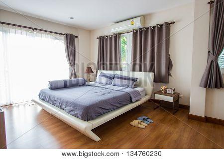 Big comfortable double bed in modern bedroom