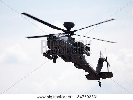 BERLIN / GERMANY - JUNE 3 2016: Boing AH-64 Apache flights on airport schoenefeld berlin / germany at june 3 2016