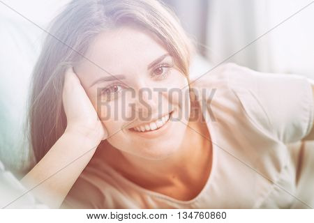 Happy Young Woman Lying On Couch At Home And Smiling. Casual Sty
