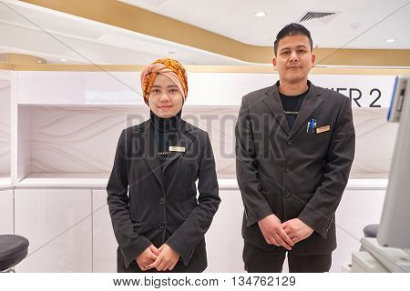 KUALA LUMPUR, MALAYSIA - MAY 09, 2016: indoor portrait of workers at Suria KLCC. Suria KLCC is a shopping mall is located in the Kuala Lumpur City Centre district.