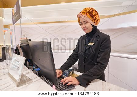 KUALA LUMPUR, MALAYSIA - MAY 09, 2016: indoor portrait of worker at Suria KLCC. Suria KLCC is a shopping mall is located in the Kuala Lumpur City Centre district.