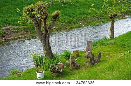 wood chairs garden furniture at the river