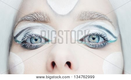frozen eyes makeup look with white hair and blue eye