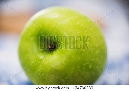 extreme close up of a green apple