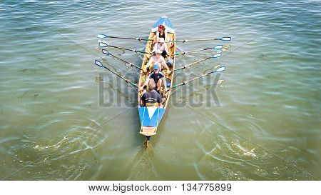 Venice Italy - May 20 2016: Female crew is training on a rowing boat in Venice.