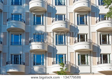 Facade of a modern apartment building with round balconies