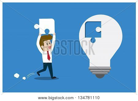 Businessman inserts the missing piece with light bulb.