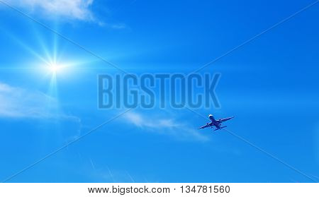 jet modern plane comes in to land on the background of sky sun