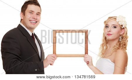 Wedding day. happy young couple with empty frame for photos. Isolated on white