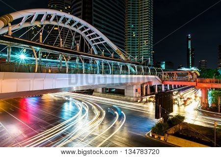 Beautiful And Colorful Light Trails Of The Vehicles Under The Skywalk At Night At The Intersection O