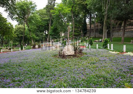 ISTANBUL TURKEY - JUNE 19 2015: People relaxing in Gulhane park in the historical center of Istanbul Turkey