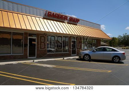 SHOREWOOD, ILLINOIS / UNITED STATES - AUGUST 21, 2015: One may have one's hair cut at the Plaza Barber Shop, in a Shorewood strip mall.