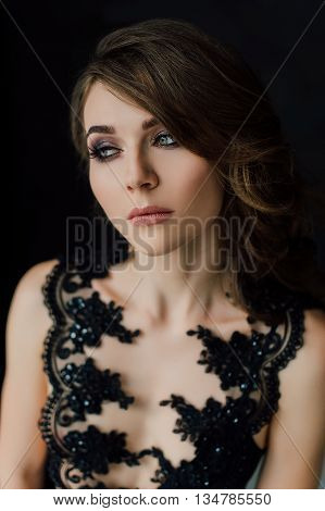 Close Up. Individuality. Thoughtful Elegant Lady In Black Prom Evening Dress. Studio Retouched Photo