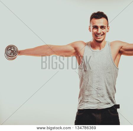 Strong Fit Man Exercising With Dumbbells.
