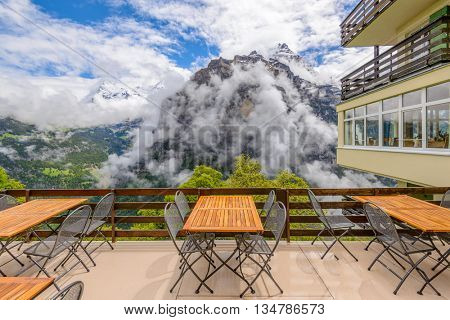 View from hotel or restaurant veranda in the Swiss Alps. Fantastic mountain view. Jungfrau Region.