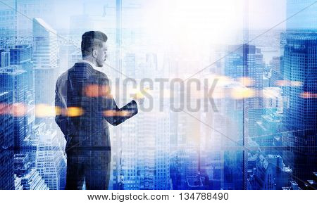Stylish young businessman using smart phone on New York city background. Double exposure