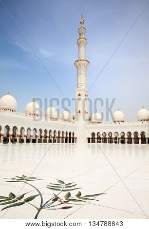 ABU DHABI, UAE - APRIL 23, 2014: Inner courtyard of Sheikh Zayed Mosque in Abu Dhabi. Mosque designed by Yusef Abdelki and opened in 2007.