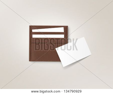 Brown leather card holder with blank white card mock up isolated on grey. Business credit cards mockup in sleeve cardholder pocket. Clear paper employee id cards in grey wallet box. Logo design card.