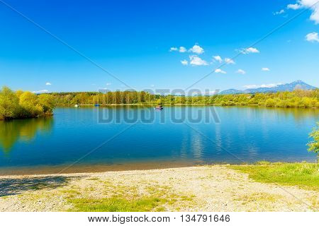Houseboat on the lake, and trees in the background. Slovakia, Central Europe, region Liptov
