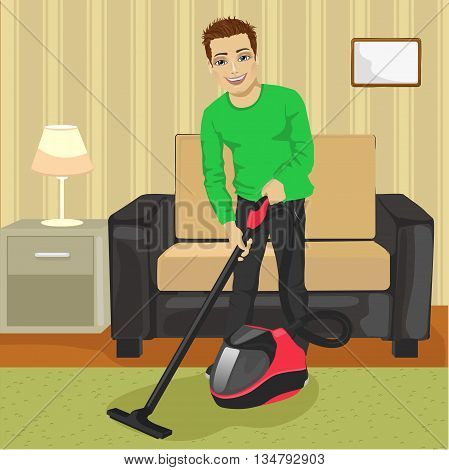 Full length of young man cleaning carpet with vacuum cleaner at home