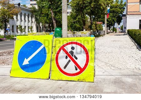SAMARA RUSSIA - JUNE 12 2016: Road signs at the under construction sidewalk in summer day