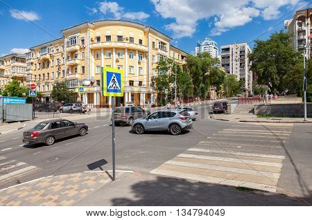 SAMARA RUSSIA - JUNE 12 2016: Pedestrian crossing with traffic signs and vehicles on the city street in summer sunny day