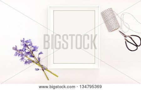 Styled stock photography bluebells on a white wooden floorboard background with scissors and twine. 10x8