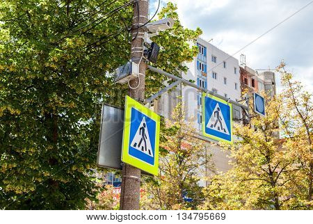Traffic sign pedestrian crossing with CCTV camera and other equipment