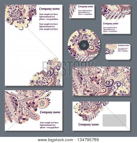 Set of templates for cd disks envelopes notebooks credit card business card and invitation card with doodle ornament. Corporate style vector.