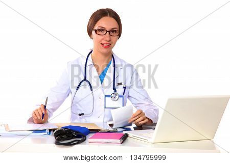 young girl doctor sits at a desk in the Office.