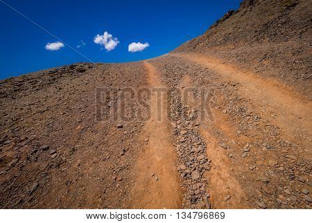Dry gravel road in the southern Lanzarote, Canary Islands, Spain