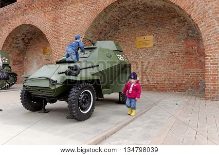 Nizhny Novgorod, Russia - May 3.2013. Children playing on the armored car BA-64 at exhibition of military equipment of times of World War II in the Kremlin of Nizhny Novgorod.