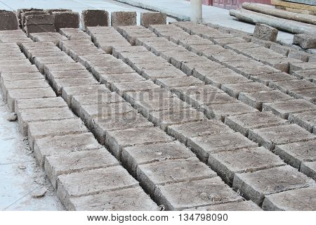 Rows of adobe bricks drying in the sun in Peru