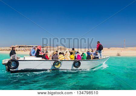 PARADISE ISLAND, EGYPT - FEBRUARY 12: Tourists on dive boat going snorkeling on Paradise Island.
