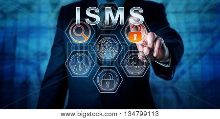 Male corporate security administrator is pushing ISMS on an interactive touch screen display. Business and IT risk metaphor and data security concept for information security management system.