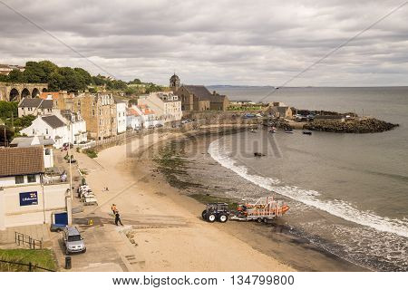 KINGHORN SCOTLAND - 20 AUGUST 2014 - RNLI lifeboat and volunteer crew return to the slipway after an exercise at the pretty Fife coastal town of Kinghorn