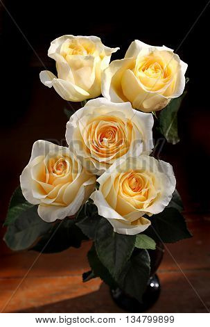 Bouquet of beautiful tea roses in a vase