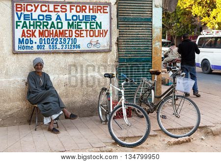 LUXOR, EGYPT - FEBRUARY 10, 2016: Local man renting bikes on street.