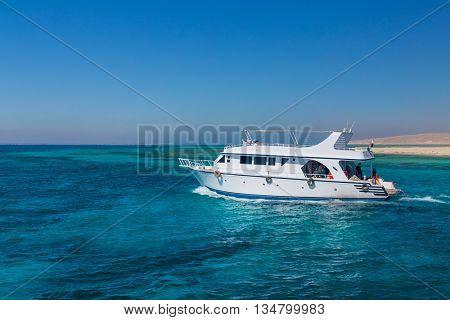 HURGHADA, EGYPT - FEBRUARY 12, 2016: Boat transporting tourists to Paradise Island.